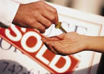 handing-over-keys-sold-sign